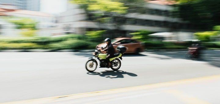 Big Motorbike Passing Through Busy Street
